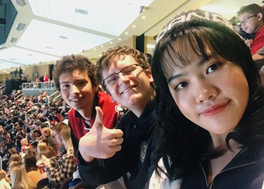 Vietnam student, Jenny, with her friends at a concert.