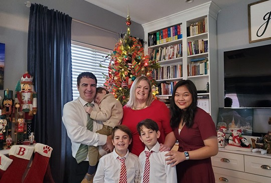 Chinese international student with her American host family at Christmas