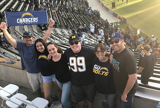 Emma and her host family at a San Diego Chargers game