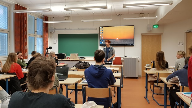 Exchange student doing a school presentation in Finland