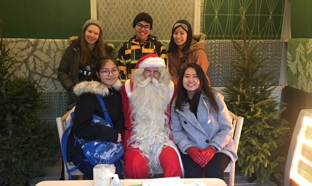 Exchange students with Santa Claus in Helsinki