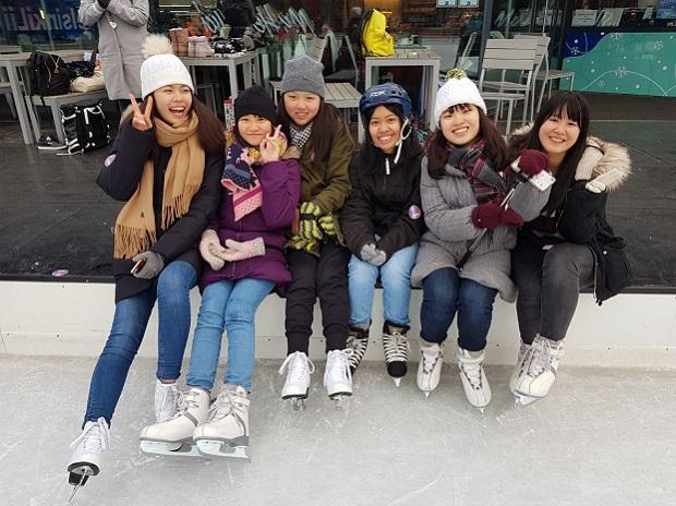 Group of exchange students enjoying Helsinki winter skating