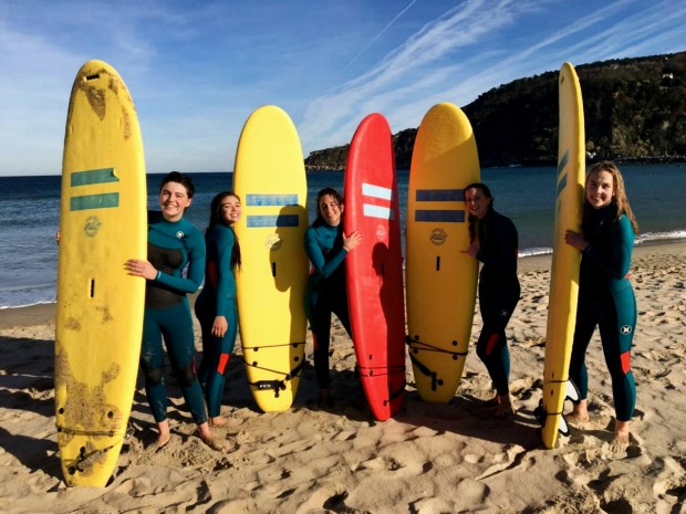 exchange students with surfboards in spain