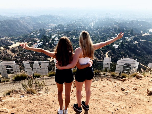 girls above the hollywood sign in los angeles