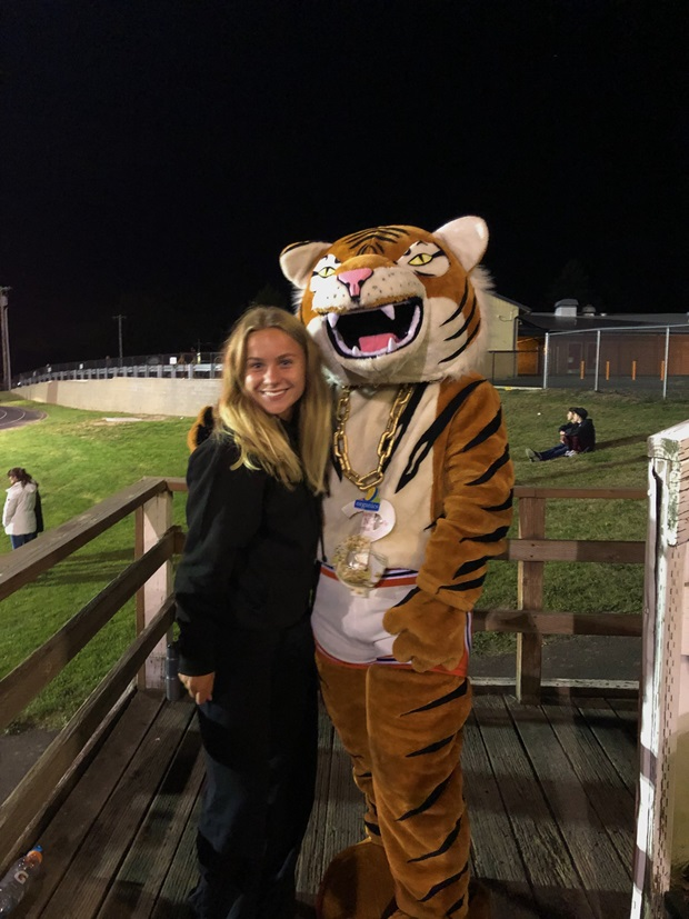girl and a school mascot
