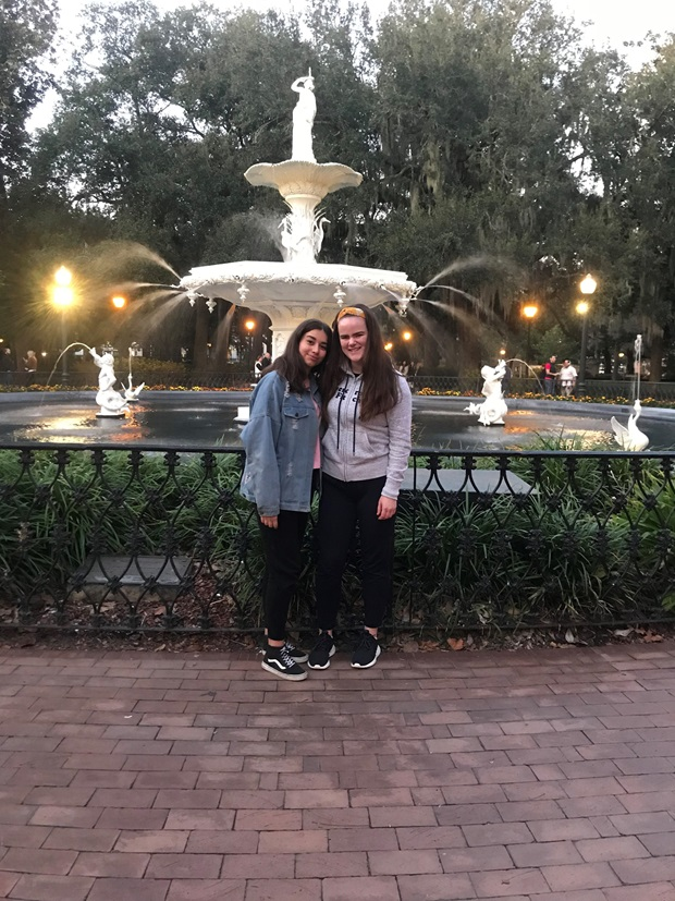 two girls in front of a fountain