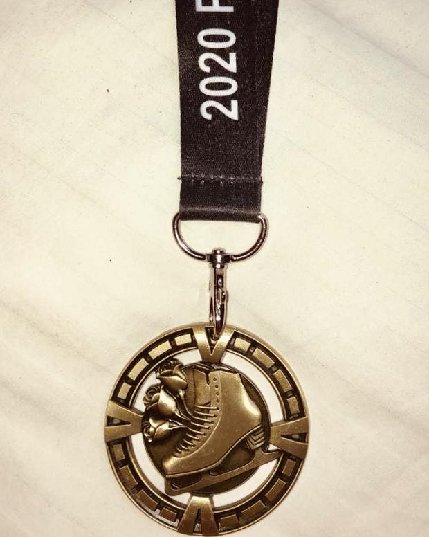 Medalj i skridskor