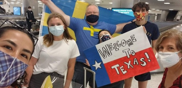 Host family welcomes student at airport