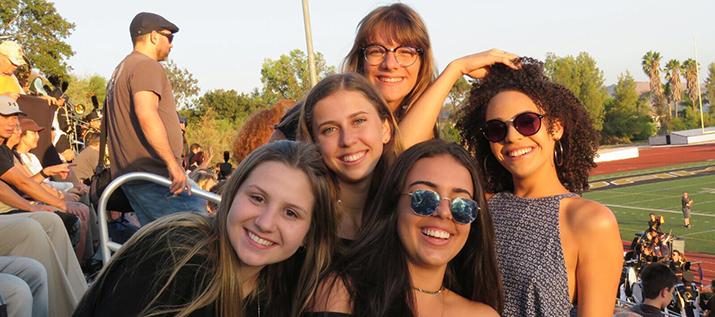 Oak Park international students enjoy a friday night football game.