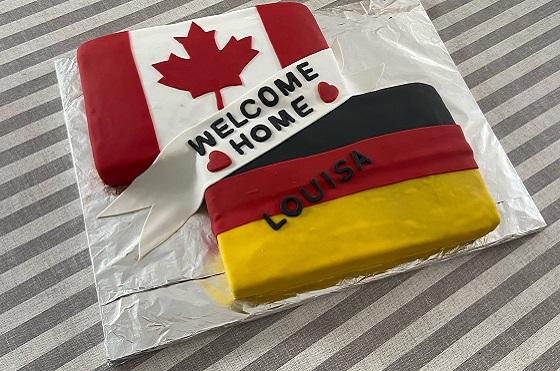 Welcome Back Kuchen mit deutscher und kanadischer Flagge