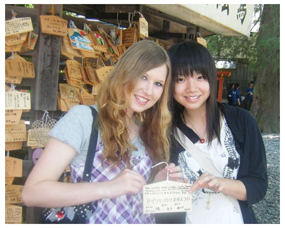 Japan Friends with a small sign