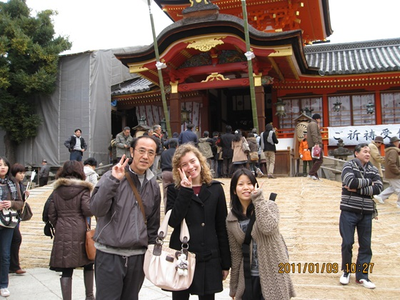 Japan Girl and host family in front of a temple
