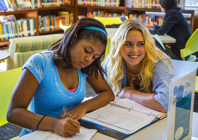 2 female high school students in a classroom