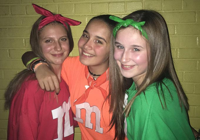 Spanish exchange student with her friends at a halloween party