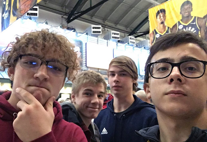 Lorenzo, from Brazil, takes a selfie with his friends at a Pacers basketball game