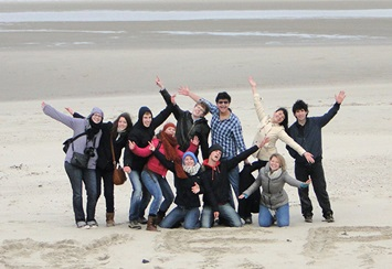 Group of high school students on a beach in Belgium
