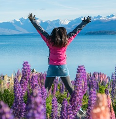 teen in front of New Zealand lake