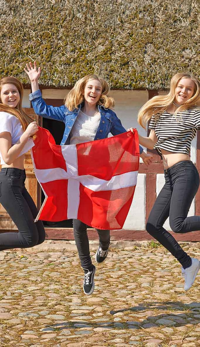 Students holding Danish flag