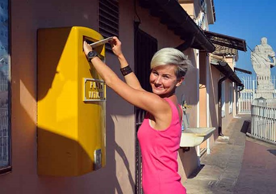 Student mails a letter home on her study abroad adventure