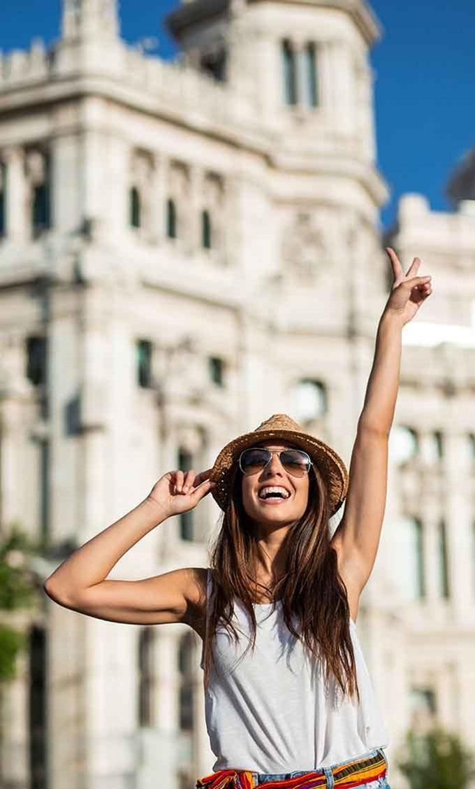 Spanish student celebrates outside a landmark, in Madrid