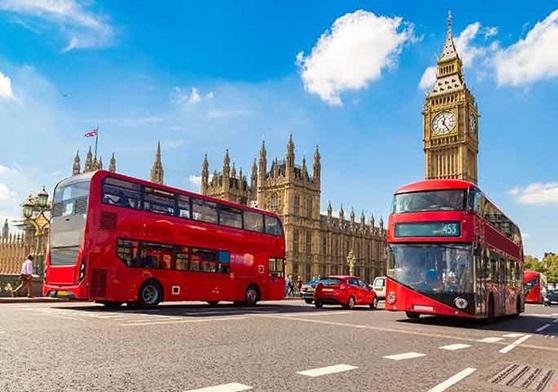 London buses passes the Parliament building