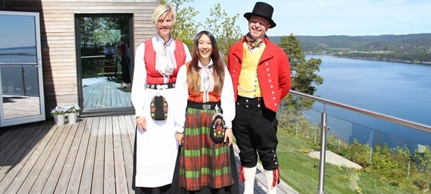 Exchange student and host family dressed up for Norweigan holiday