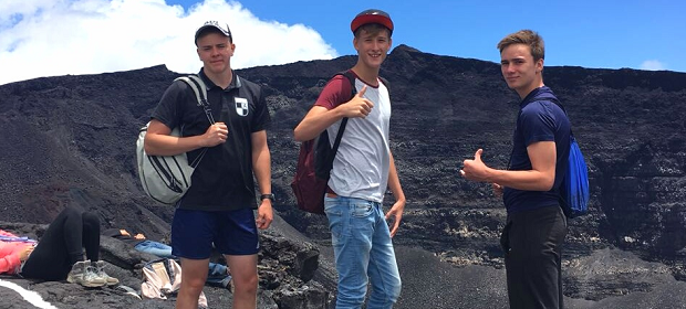 Three boys making thumbs up in Reunion