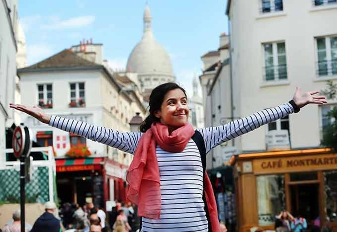 Student with Sacré-Cœur in the City of Paris, Île-de-France, France