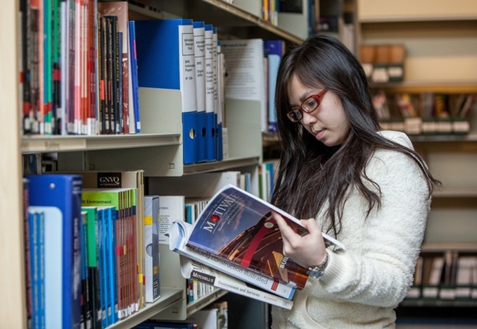 Student in library at Greater Brighton Metropolitan College