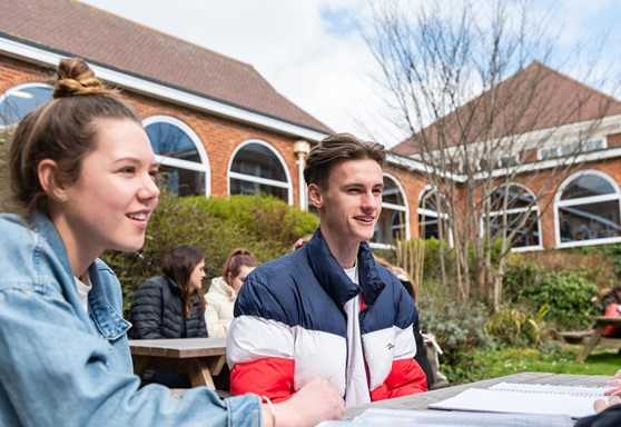 Students studying on grounds of Varndean College