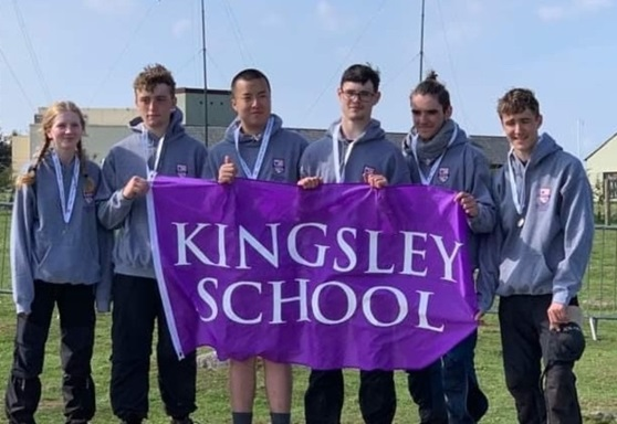 Students with school flag at Kingsley School