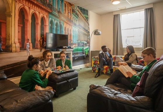 Boarders in common room at Stover School