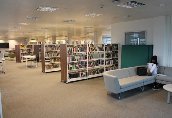 Girl in library at Worthing College