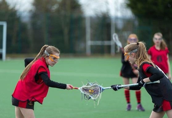 Girls playing lacrosse at Birkenhead School