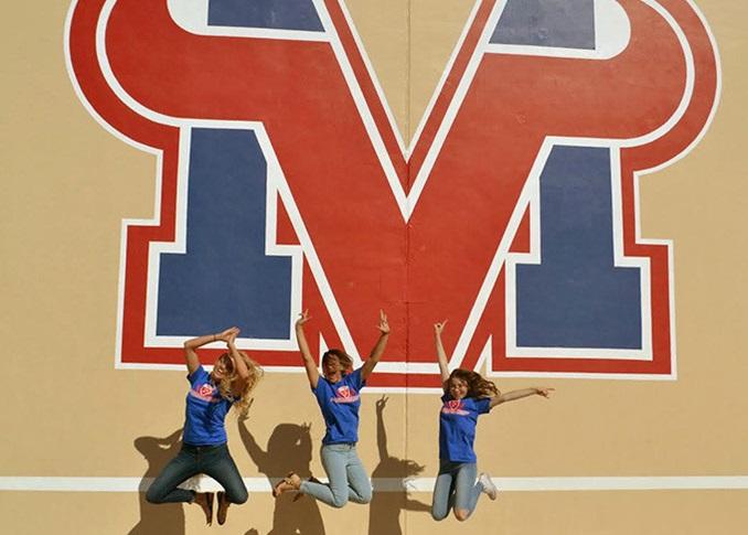 Three Girls Jumping at Mesa Public Schools