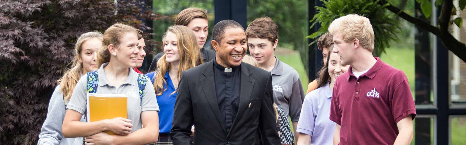GibaultCatholicHighSchool-Private-IL-Students-with-Priest-Banner-2021