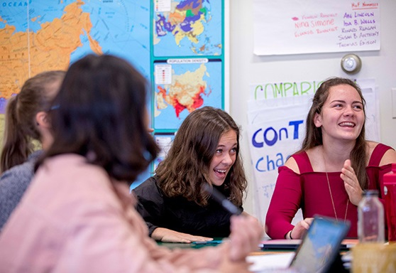 Girls Laughing in Classroom at Hebron Academy Maine