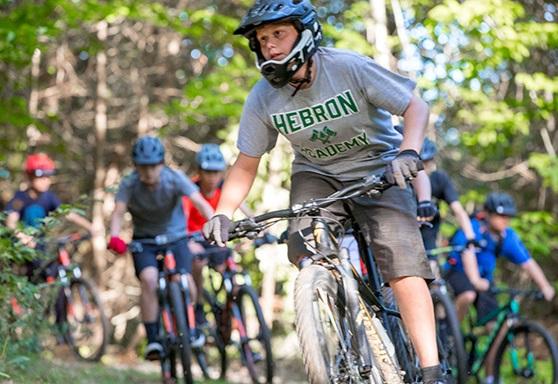 Boy Mountain Biking at Hebron Academy Maine
