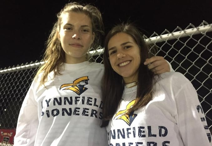 Two Girls at Sports Match at Lynnfield High School in Massachusetts USA
