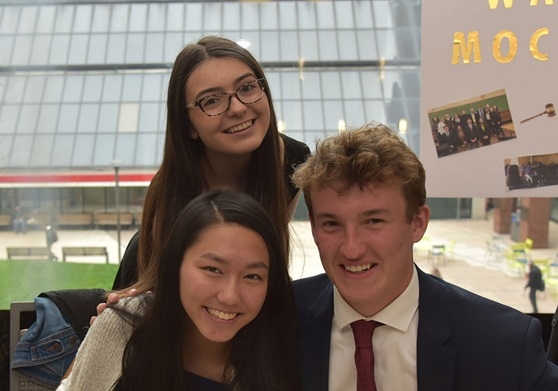 3 high school students smiling