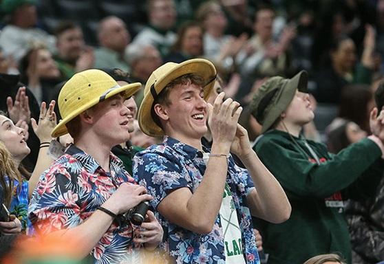 2 high school boys cheering at a pep rally