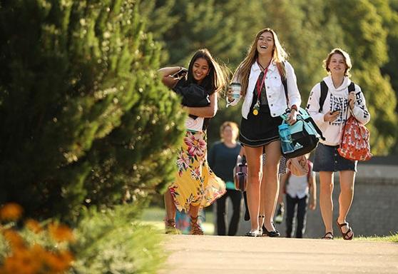 Girls walking outdoor at Saint Johns Preparatory School in Astoria, NY