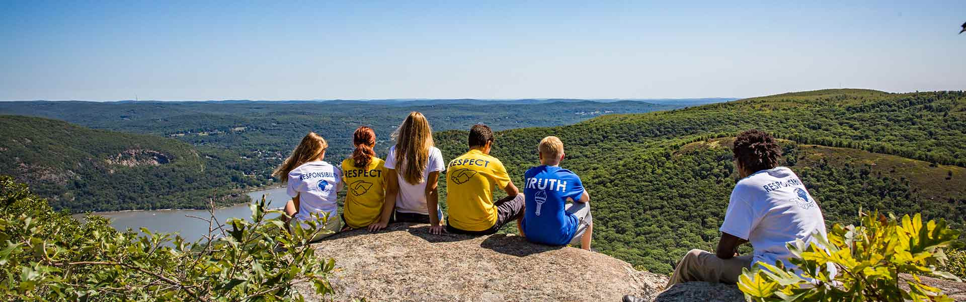 Group of students from the The Storm King School in New York sitting on a mountain top