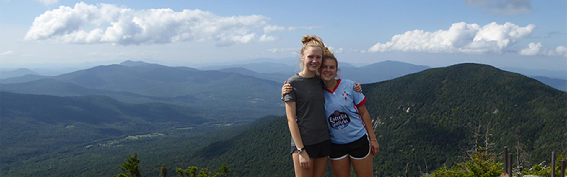 2 girls smiling with a mountain background Vermont Academy