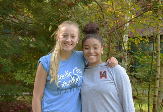 2 girls smiling outside Vermont Academy