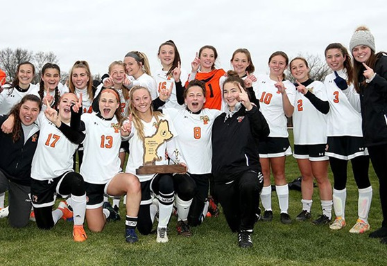 Girls soccer team with a trophy Vermont Academy